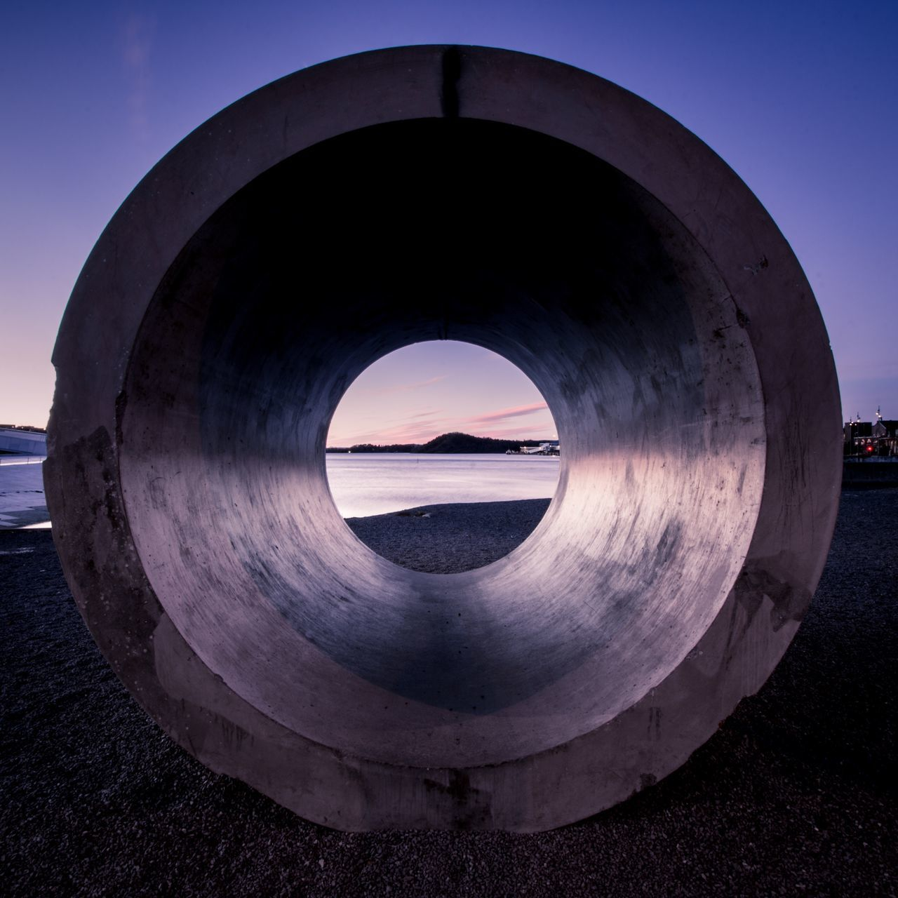 Pipe at beach against sky