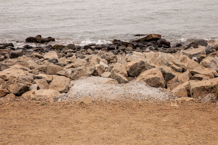 Beach Beauty In Nature Breaking Day Land Motion Nature No People Non-urban Scene Outdoors Rock Rock - Object Rocky Coastline Sand Scenics - Nature Sea Solid Tranquil Scene Tranquility Water Wave