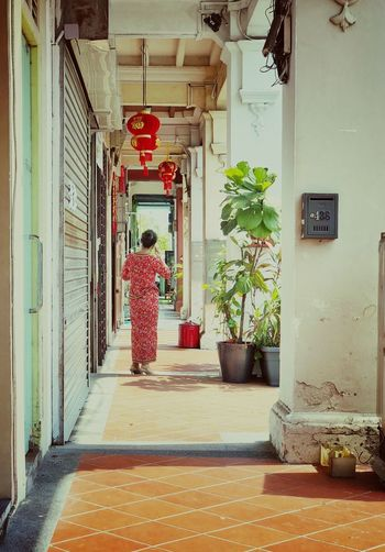 Streetphotography Streetphoto_color Oldshophouse Old Buildings Architecture Rear View Built Structure Real People Building Day Footpath