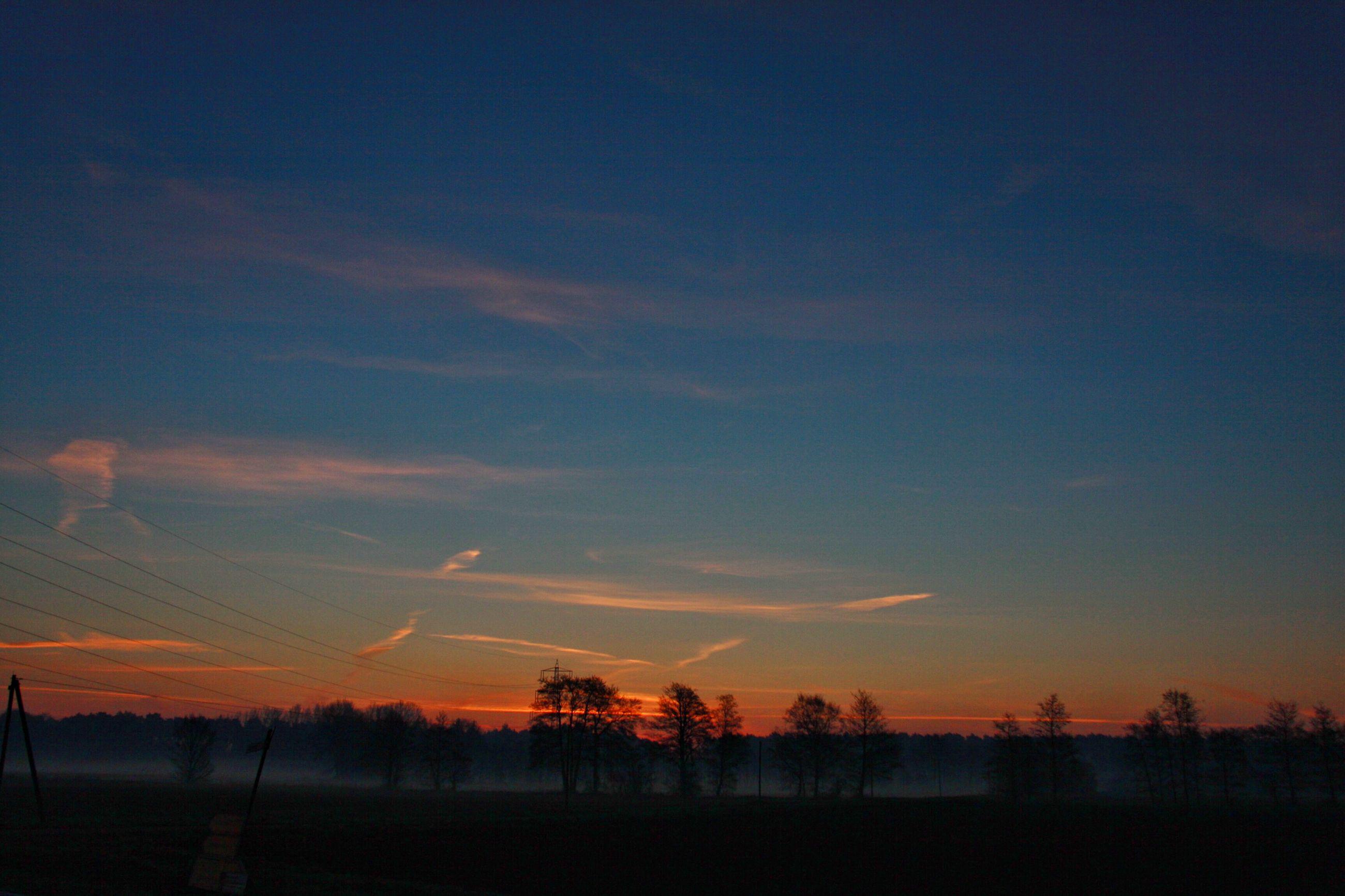 sunset, tranquil scene, tranquility, silhouette, scenics, beauty in nature, sky, landscape, orange color, nature, tree, idyllic, field, dusk, non-urban scene, cloud - sky, outdoors, no people, lake, majestic