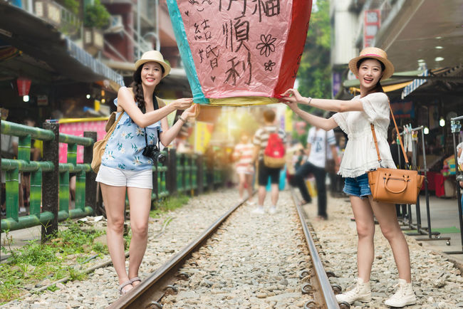 Asian  Holiday Taiwan Tourist Adult Casual Clothing Day Fire Flying Full Length Happiness Looking At Camera Outdoors People Pingxi Portrait Real People Sky Lantern Smiling Standing Tourism Travel Destinations Vacation Young Adult Young Women