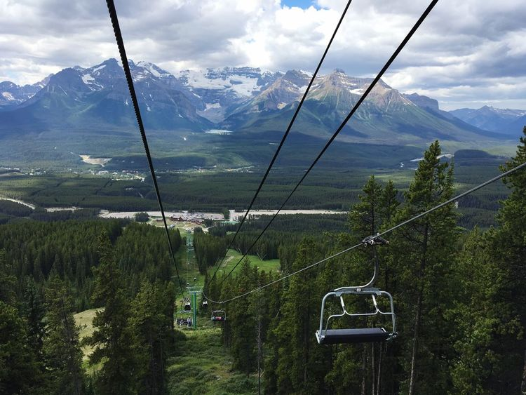 Mountain Beauty In Nature Scenics - Nature Mountain Range Sky Overhead Cable Car Cable Car Cable Plant Landscape Cloud - Sky Tranquil Scene Nature Non-urban Scene Environment Day Transportation Tranquility Ski Lift Tree