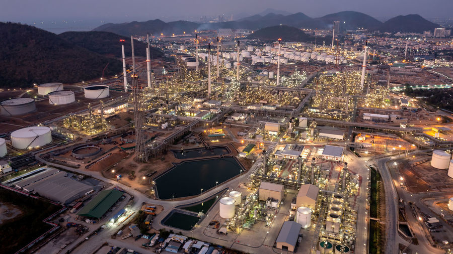 Aerial top view at twilight oil and gas refinery background, business petrochemical industrial,