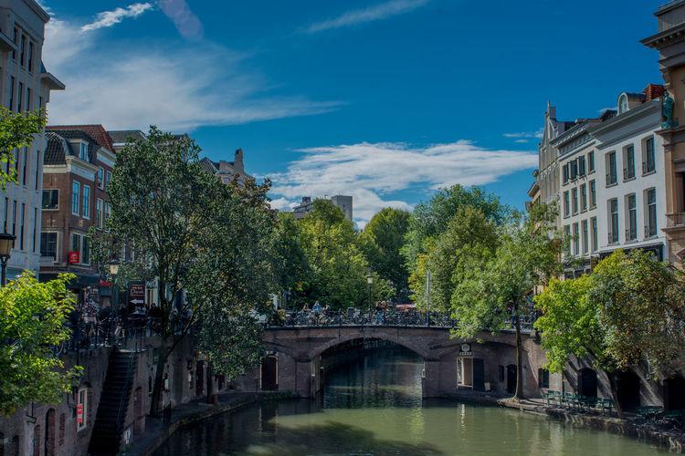 The canals of the Dutch city Utrecht Utrecht Utrecht , Netherlands Canal Canals And Waterways Nederland Netherlands City Tree Water Cityscape Blue Sky Architecture Building Exterior Built Structure Arch Bridge