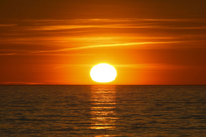 Sunset Sea Sun Sunlight Horizon Over Water Tranquility Beauty In Nature Scenics Nature Yellow Outdoors Dramatic Sky No People Water Beach Sky Day
