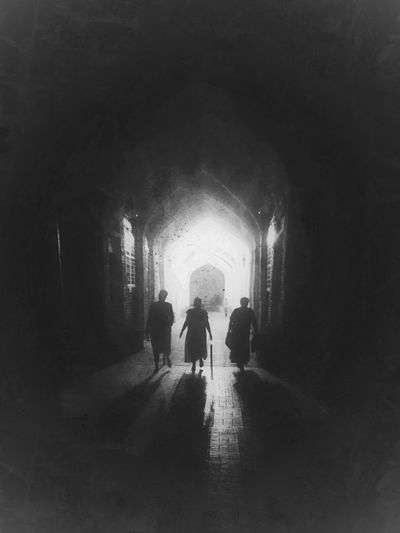 The ancient City of Bukhara Uzbekistan, People and Places - Silk Road in Central Asia Blackandwhite Photography Bukhara Dark Diminishing Perspective Full Length Group Of People Illuminated Leisure Activity Lifestyles Silhouettes Silk Road Streetphotography The Street Photographer - 2016 EyeEm Awards The Way Forward Tunnel Uzbekistan Walkway An Eye For Travel
