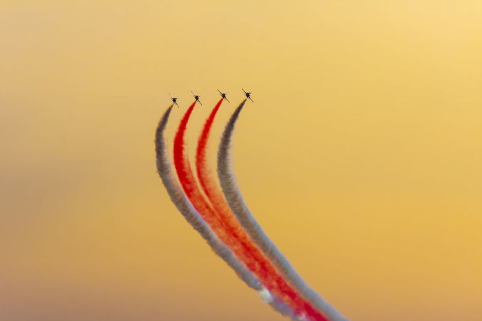 Turkish acrobatic aviation squadron flying over Izmir (Turkey) Izmir Turkey Acrobacy Acrobatics  Air Vehicle Airplane Airshow Aviation Fighter Plane Flying Formation Flight Military Airplane Motion Multi Colored No People Performance Skills  Sky Speed Sunset Teamwork Transportation Turkish