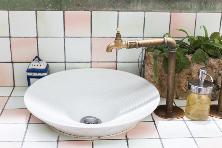 Brass faucet vintage design on wash basin. Absence Bathroom Close-up Container Domestic Bathroom Domestic Room Faucet Flooring Home Home Interior Household Equipment Hygiene Indoors  Nature No People Sink Table Tile Tiled Floor Toilet Wall - Building Feature