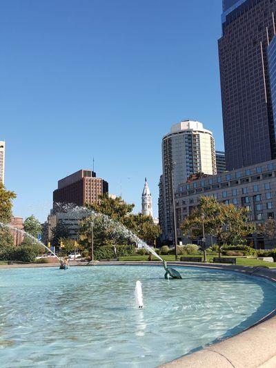 City skyline against clear blue sky