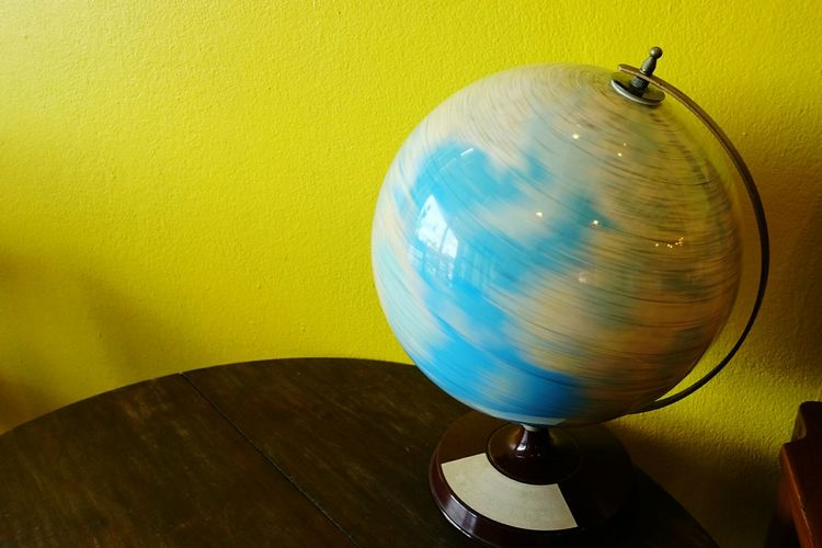 Close-up of spinning globe on table