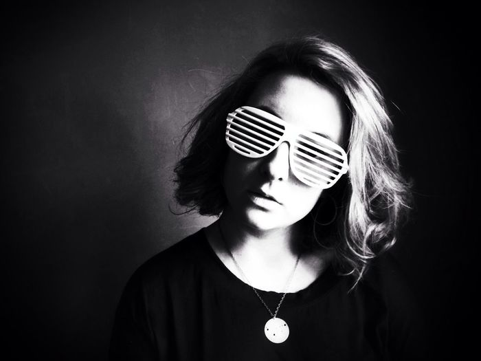 Portrait of young woman wearing striped sunglasses