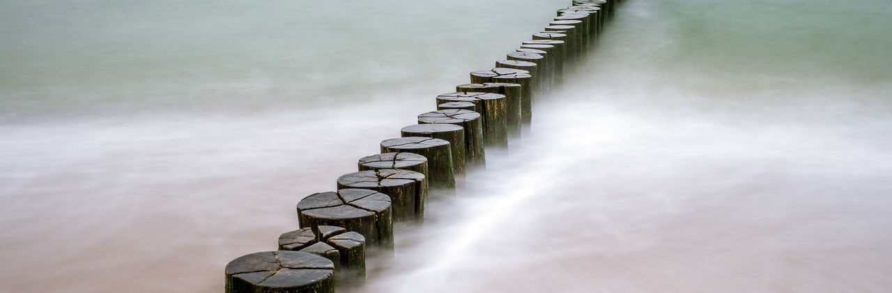 Breakwater in Warnemuende Baltic Sea Ostsee Ostseeküste Absence Architecture Backgrounds Beauty In Nature Breakwater Chain Connection Copy Space Day Direction In A Row Metal Nature No People Order Outdoors Repetition Selective Focus Textured Effect Water Wood - Material