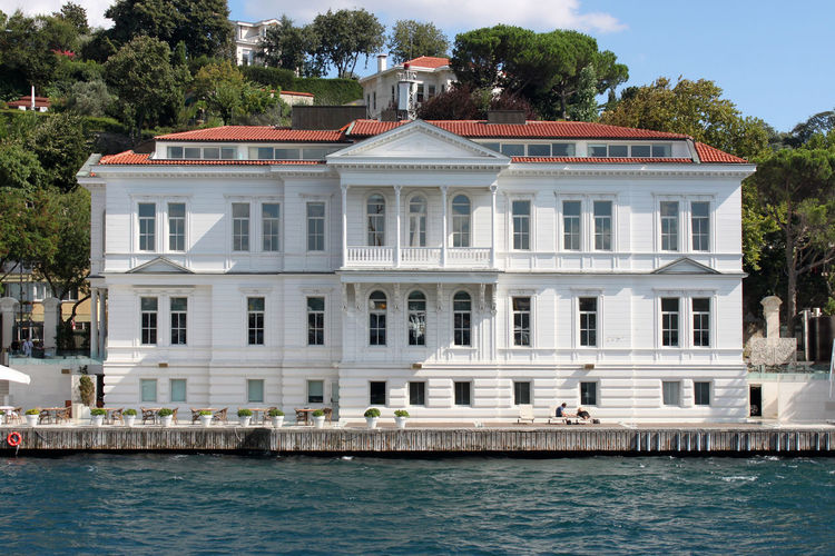 White wooden palace standing on the Bosphorus banks in Istanbul Architecture Banks Land Painted Pier Promenade Sightseeing Wood Bank Bosphorus Building Hotel Landmark Monument Museum Neo Classical Architechture Palace Pediment Real Estate River Sight Symmetrical Symmetry White Wooden