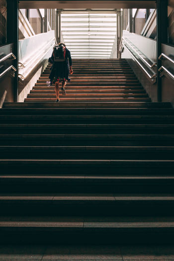 Low angle view of woman walking on stairs