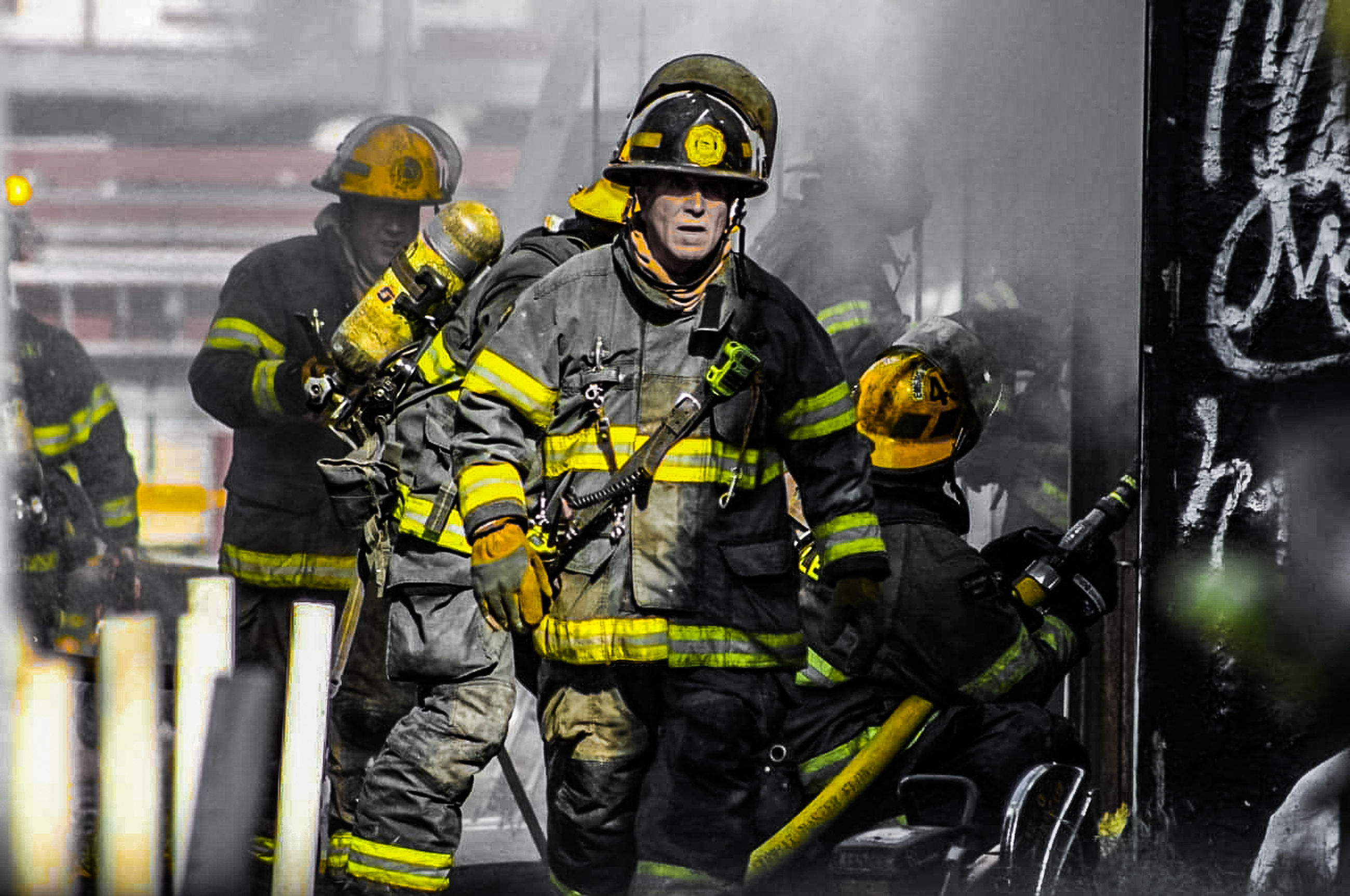 firefighter, accidents and disasters, headwear, clothing, occupation, sign, protection, rescue worker, adult, fire, men, emergency services occupation, communication, protective workwear, warning sign, helmet, burning, sports, cooperation, healthcare and medicine, risk, extinguishing, person, emergency equipment, security, fire hose, teamwork, hose, courage, two people, rescue, uniform, equipment, smoke, standing, day, outdoors, emergency service, spraying