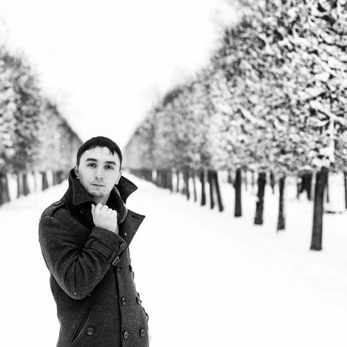 Winter Snow Portrait Cold Temperature Young Adult Looking At Camera One Person Warm Clothing Confidence  Tree Nature People Outdoors Man Day Looking At Camera