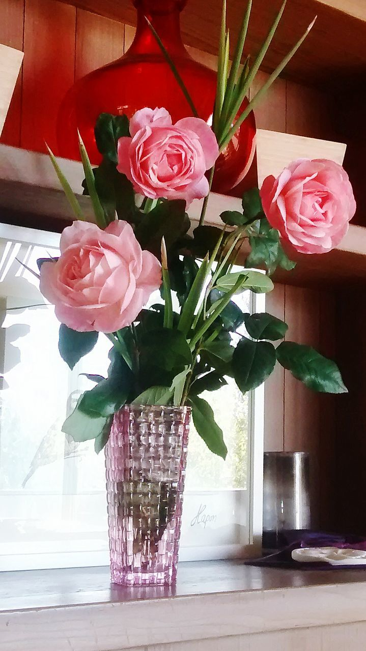 Roses In Vase On Window Sill