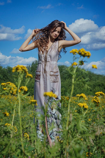 Flower Sky Nature Real People One Person Beauty In Nature Lifestyles Women Hair Yellow Field Young Women Cloud - Sky Standing Hairstyle Leisure Activity