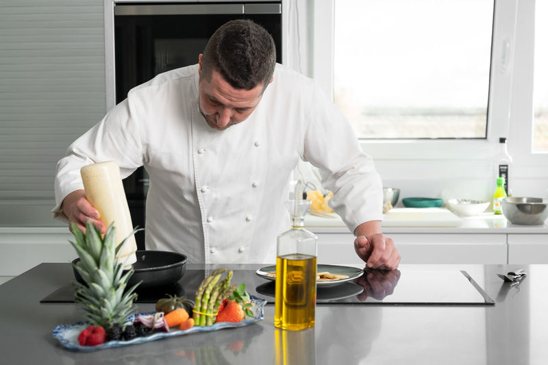 Mid adult man preparing food in kitchen