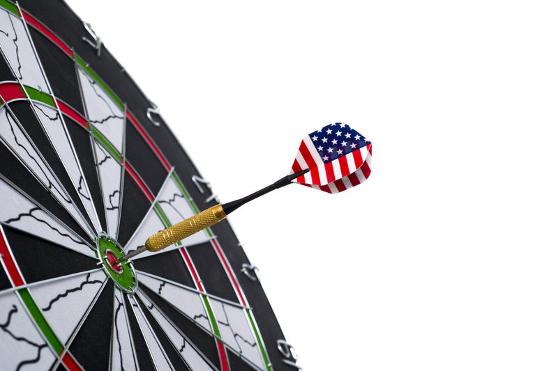 Center target of darts isolated on a black background Object Game Concept Circle Success Closeup Background Dart Dartboard Strategy Sport Board Marketing Target Business Center Winner Point Objective Arrow Bullseye Financial Targeting Symbol Perfect Mark Perfection Metaphor Targeted Planning Light Challenge Market Win Goals Achievement Aim Idea Score Hit Spot Audience Archery Number Play Accuracy Recreation  Leisure Competition Flag Sky Patriotism Copy Space Low Angle View Clear Sky No People White Background Shape Nature Studio Shot Day Outdoors Sports Target Amusement Park Amusement Park Ride Motion National Icon Directly Below