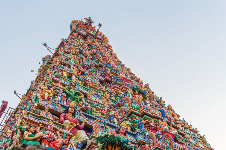 Hindu god and goddess sculptures on temple tower Gopuram Hindu Gods Hinduism Tamil Architecture Building Exterior Clear Sky Colorful Culture And Tradition Day Goddess Hindu Temple Low Angle View Multi Colored Mylapore No People Outdoors Religious  Sculptures Sky Temple Architecture Templephotography Tower