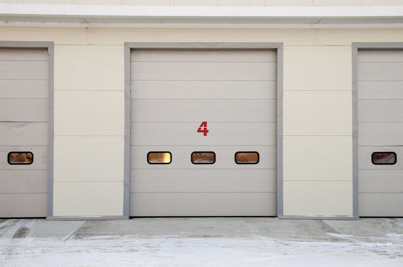 Front wall of car repair station with numbered doors