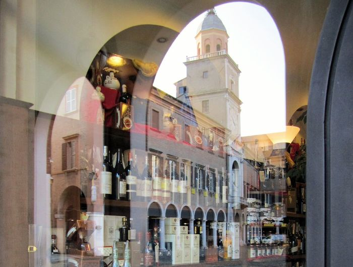 While it's the Cathedral (Duomo), Torre Civica and Piazza Grande that interest UNESCO a visit to Modena wouldn't be complete without purchasing some Aceto Balsamico Tradizionale and other regional products. Modena is located on the south side of the Po Valley, in the Province of Modena and the Emilia-Romagna region of Italy. http://pics.travelnotes.org Arch Balsamic Vinegar Bottles Cathedral City Duomo Fine Art Photography Gastronomy Italian Italy Michel Guntern Modena Reflections Cut And Paste Shopping Street Photography The Mix Up The Tourist Travel Travel Photography Travel Photos Travel Pics UNESCO World Heritage Site Neighborhood Map Window