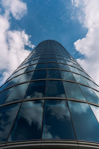 EyeEm Selects Cloud - Sky Low Angle View Sky Built Structure Architecture Tall - High Building Exterior No People Building Day Modern Glass - Material Reflection City Outdoors Skyscraper