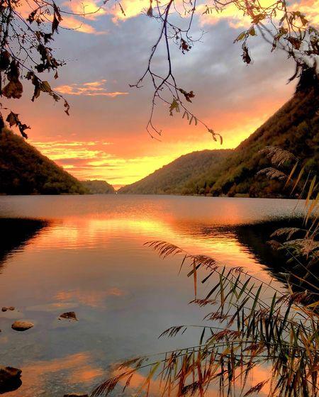 Passeggiando lungo il lago del Segrino, Italy Italy🇮🇹 Lago Del Segrino  Sunset Sky Water Cloud - Sky Beauty In Nature Tranquility Scenics - Nature Tranquility Beauty In Nature Tranquil Scene Orange Color Tree Plant Reflection Lake Nature No People Non-urban Scene Idyllic Silhouette Outdoors Romantic Sky