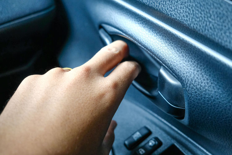 Adult Body Part Car Car Interior Close-up Control Control Panel Dashboard Finger Gripping Hand Human Body Part Human Hand Indoors  Land Vehicle Mode Of Transportation Motor Vehicle One Person Transportation Vehicle Interior