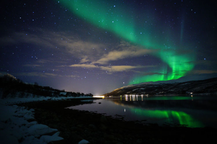 Aurora Borealis Northern Lights Norway Travel Photography Tromsø Winter Astronomy Aurora Polaris Beauty In Nature Constellation Galaxy Green Color Illuminated Lake Mountain Nature Night No People Outdoors Polar Night Reflection Scenics Sky Space Star - Space Star Field Svalbard  Tranquil Scene Tranquility Travel Destinations Water