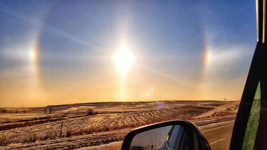 Sun dogs Sun Dogs In The Sky Sunhalo Rural Scene Country Life Country Road Gold Colored Wintertime Sunglare EyeEmNewHere Scenics Windmill Windturbines Countryside Country Living Iowa Sundog Winter Freezing Cold EyeEm Selects Sunset Car Sun Sky Car Point Of View Rear-view Mirror Cold