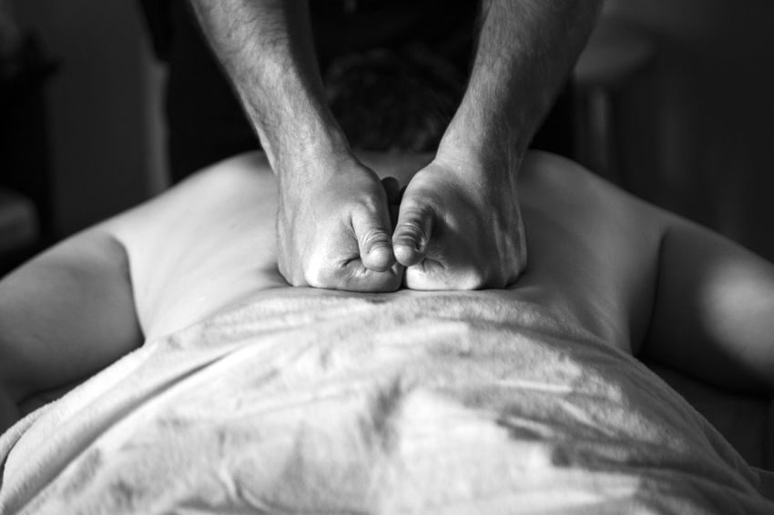 Massage in action Body & Fitness Hands At Work Lifestyle Swedish Massage Black And White Body Part Close-up Contour Curly Hair Day Indoors  Lines, Shapes And Curves Malemodel  Massage Massage Studio Massage Therapy Masseuse Real People Relaxation Shiatsu Spa