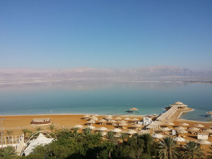 Dead Sea, Totes Meer Water Nautical Vessel Copy Space Transportation Clear Sky Mode Of Transport Blue Sea Boat High Angle View Scenics Architecture Shore Building Exterior Tranquil Scene Tranquility Day Beauty In Nature Nature Sky