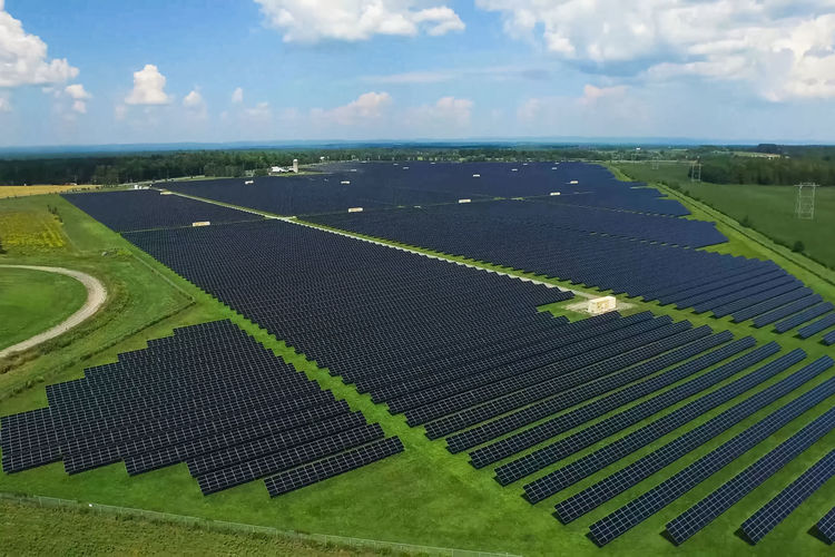 Solar panel Solar Panel Plant Energy Battery Environment Sky Landscape Cloud - Sky Land Nature Green Color Field Agriculture Day Rural Scene Scenics - Nature No People Tranquil Scene Beauty In Nature Farm Tranquility Outdoors Aerial View Grass