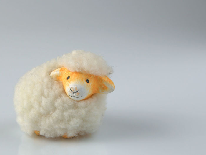 Close-up of sheep toy on table