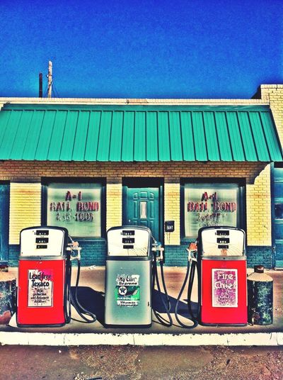 Fuel Pump Gasoline Refueling Gas Station Fossil Fuel Fuel And Power Generation Built Structure Outdoors Blue Day Old-fashioned Text No People Pay Phone Building Exterior Telephone Receiver Architecture Vintage Gas Pumps Big Spring, TX Transportation