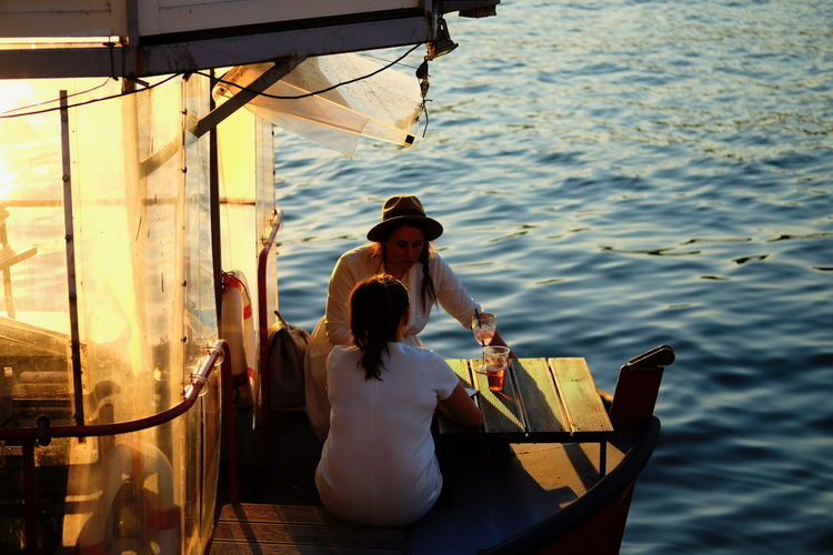 Water Nautical Vessel Real People Two People Transportation Women Adult Nature Mode Of Transportation Men Sitting Leisure Activity Lifestyles Sea People Day Young Adult Outdoors Young Men Couple - Relationship