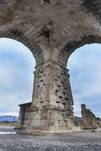 One of four pillars wich stand the Roman Arch of Caparra, Caceres, Spain Ancient Ancient Civilization Architecture Building Exterior Built Structure Cloud - Sky Day History Low Angle View Nature No People Old Ruin Outdoors Sky Travel Destinations