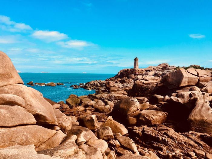 Pink granite coast Bretagne Beauty In Nature Scenics - Nature Travel Destinations Tourism Landscape Idyllic Lighthouse Côte De Granite Rose Pink Granite Coast Horizon Over Water Horizon Sea Water Sunlight Sky And Clouds Blue Sky Beach Rocky Coastline Environment Island Cliff Rock Formation Pink Color Solid Rock Eroded Day Nature