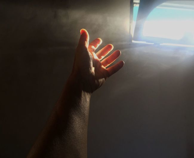 Close-up of person hand in car