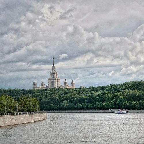 View of cathedral in city against cloudy sky