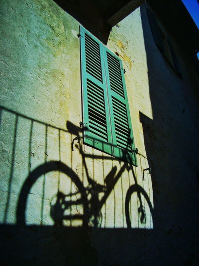 Tessin, Switzerland Architecture Bicycle Built Structure Day Land Vehicle No People Outdoors Play Of Shadow Shadow Sunlight Window EyeEmNewHere
