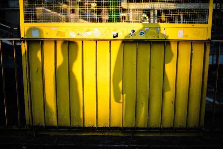 Shadow of people on barricade