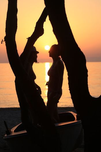 Romantic scene Sunset Silhouette Sky Water Sea Real People Orange Color Nature Two People Leisure Activity Beach Togetherness Women Lifestyles People Outdoors Adult Bonding Land Love