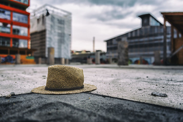 Close-up of hat against sky in city