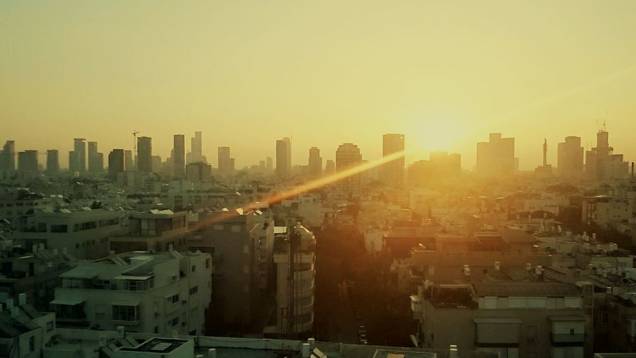 Sunset at Tele Aviv. City Architecture Cityscape Sunset Built Structure Building Exterior Skyscraper Sun Urban Skyline City Life Crowded Tower Tall - High High Angle View Window Sunbeam Building Story Office Building Sky Wide Shot