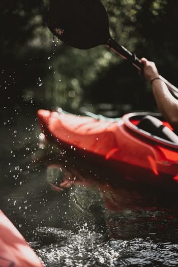 Cropped image of person kayaking in river