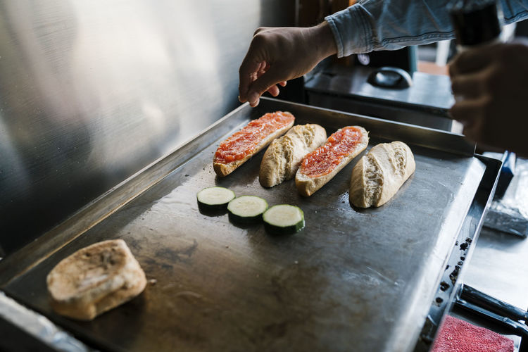 Man preparing food on cutting board