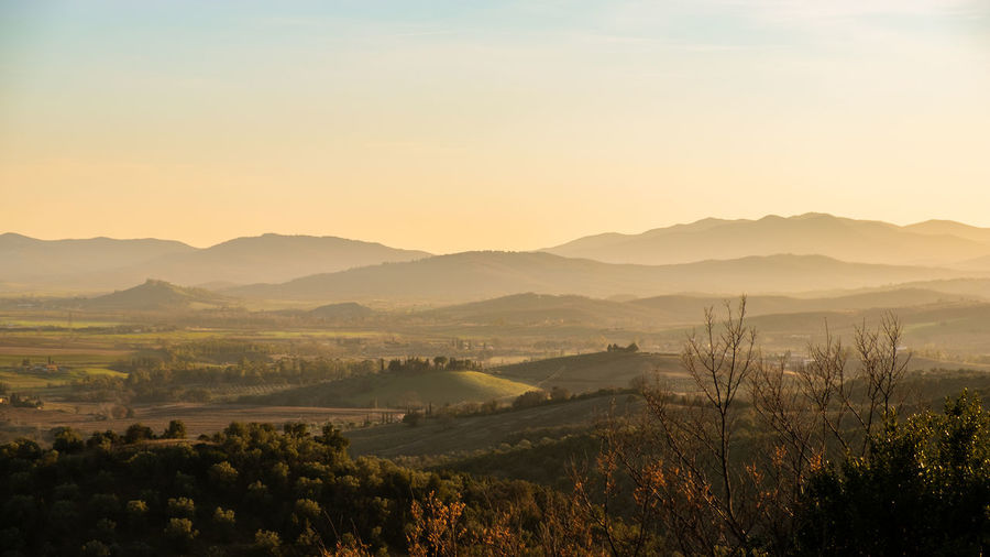 Scenics - Nature Beauty In Nature Sky Tranquil Scene Environment Tranquility Mountain Landscape Tree Plant Non-urban Scene Nature Mountain Range Idyllic No People Sunset Fog Land Copy Space Outdoors Rolling Landscape Tuscany Italy Layers Hazy  My Best Photo The Great Outdoors - 2019 EyeEm Awards